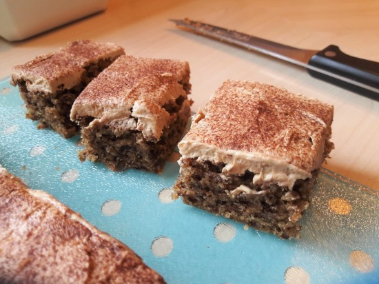 Easy recipe coffee sponge cake traybake with cappuccino buttercream dusted with cocoa sliced uk