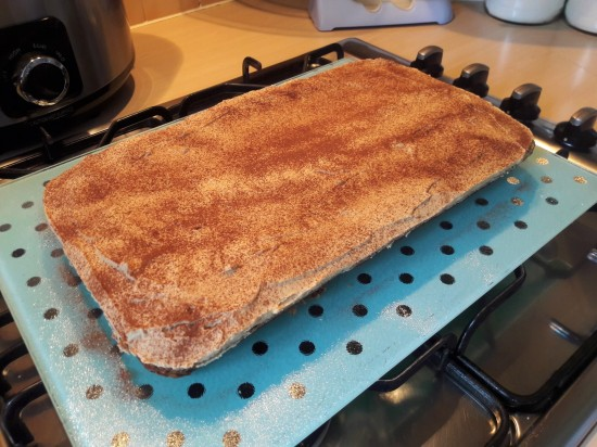 Easy recipe coffee sponge cake traybake with cappuccino buttercream dusted with cocoa uk